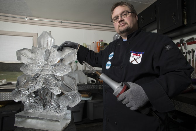 Greg Butauski is an ice carver at Rock on Ice. Greg, who has been carving ice for over 20 years, creates ice sculptures in a studio behind his house.